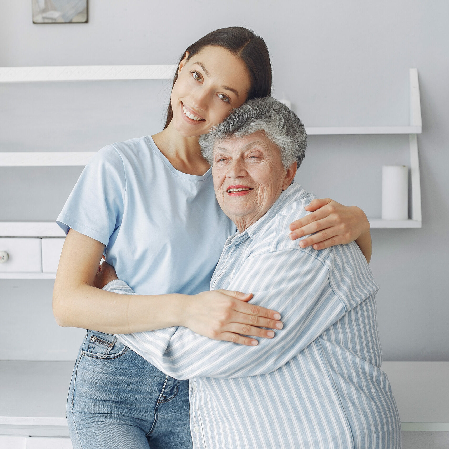 Old woman in a kitchen. Grandparents at home. Woman in a whire shirt